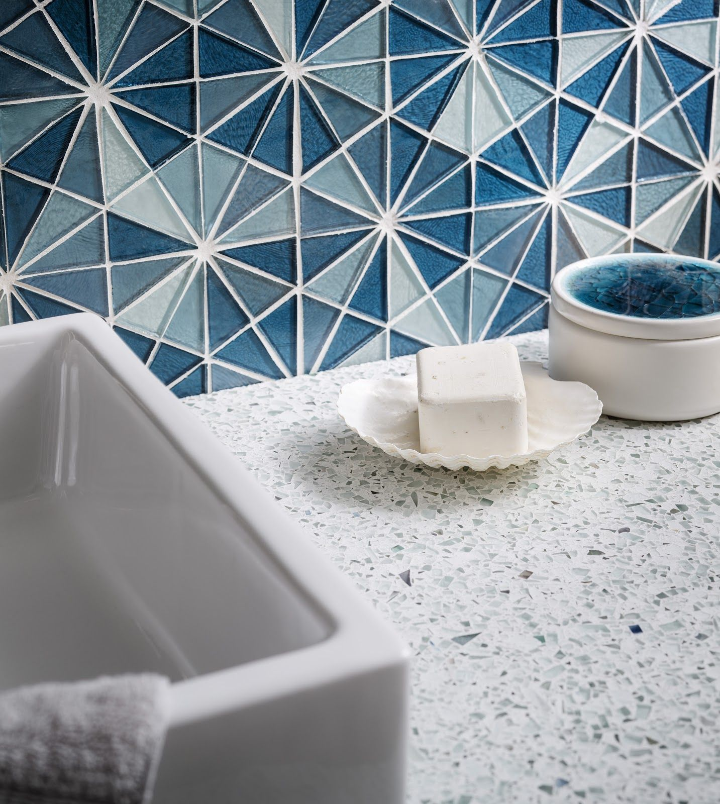 Recycled glass countertops from vetrazzo and recycled glass tiles from oceanside glass tile make the perfect match up of coastal color and sustainability