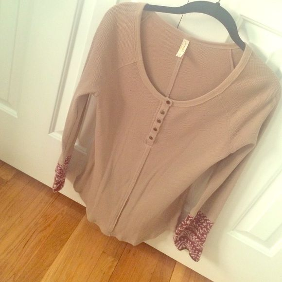Free People thermal Tan thermal with red and white cuffs from Free People. Size large. worn once, great condition! Free People Tops
