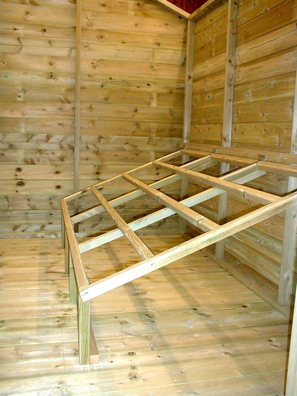 Hinged roost folds up for easy cleaning.