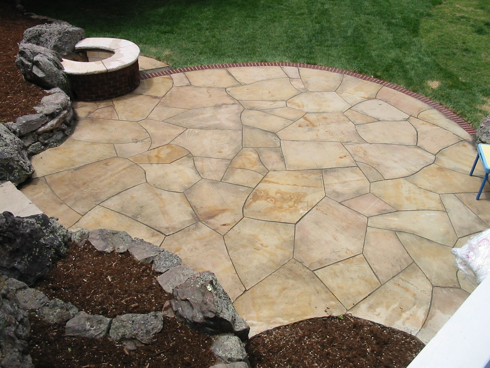 Random Cut Buff Flagstone Patio With Brick Edge And Natural Boulder Edgers.  By Native