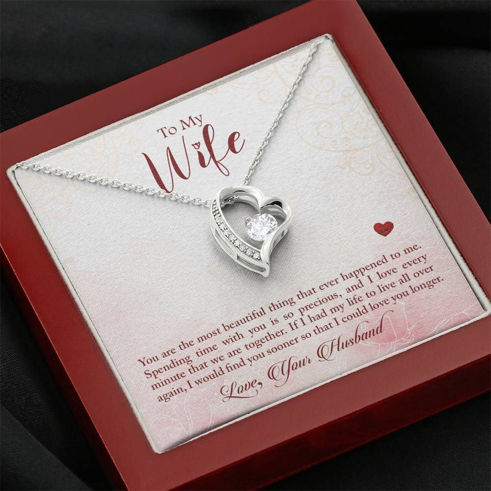 Imagine the joy on your wife's face when you give her this gorgeous Forever Love Necklace for her birthday or anniversary. This dazzling necklace features a polished heart pendant surrounding a flawless 6.5mm cubic zirconia, embellished with smaller crystals adding extra sparkle and shine.The pendant is crafted in 14K white gold finish and dangles from an adjustable cable chain secured with a lobster clasp. A beautiful keepsake gift your wife will wear and treasure. Product Details: • 14K white