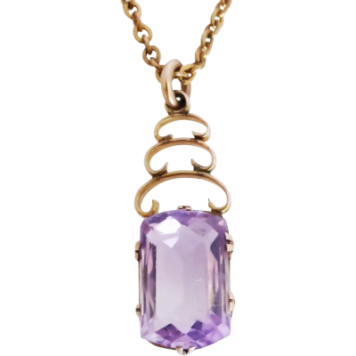 A lovely amethyst pendant dating back to early 1900's era. The pretty lavender purple natural amethyst is cut in a stunning elongated cushion.