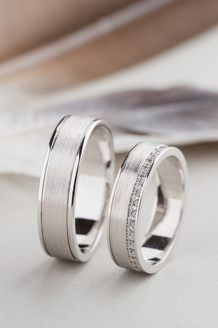 Photo of His and hers wedding bands made of 14k gold with diamonds. Matching wedding rings.