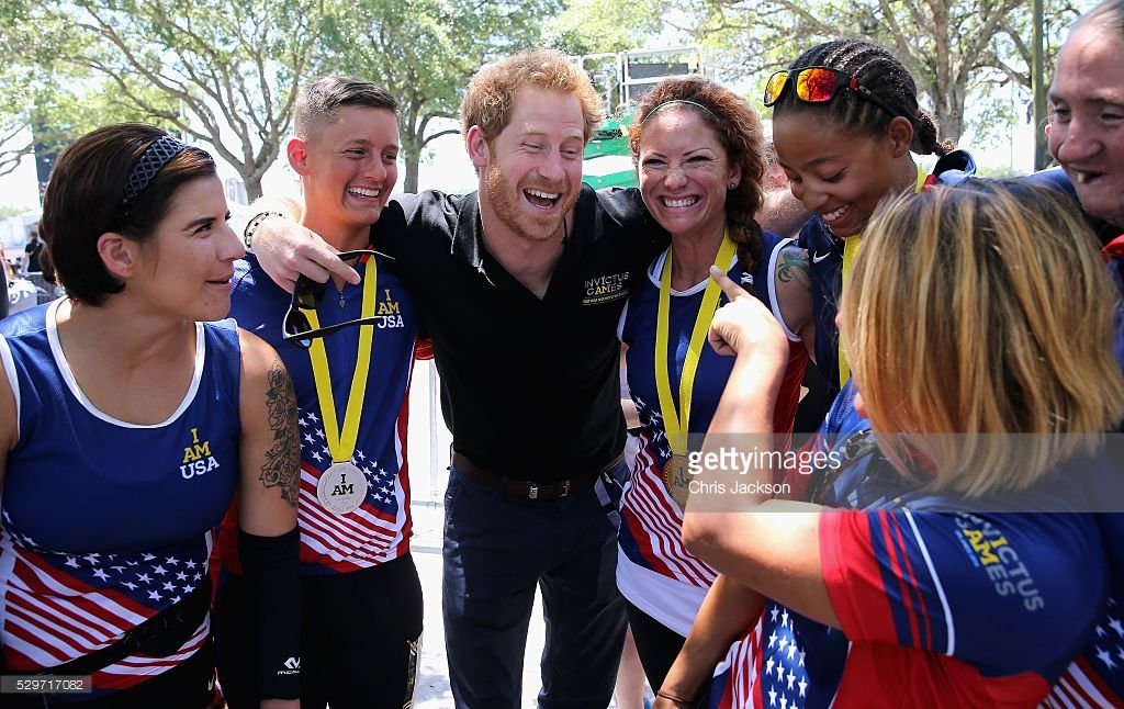 Prince Harry laughs with Team USA at the road cycling