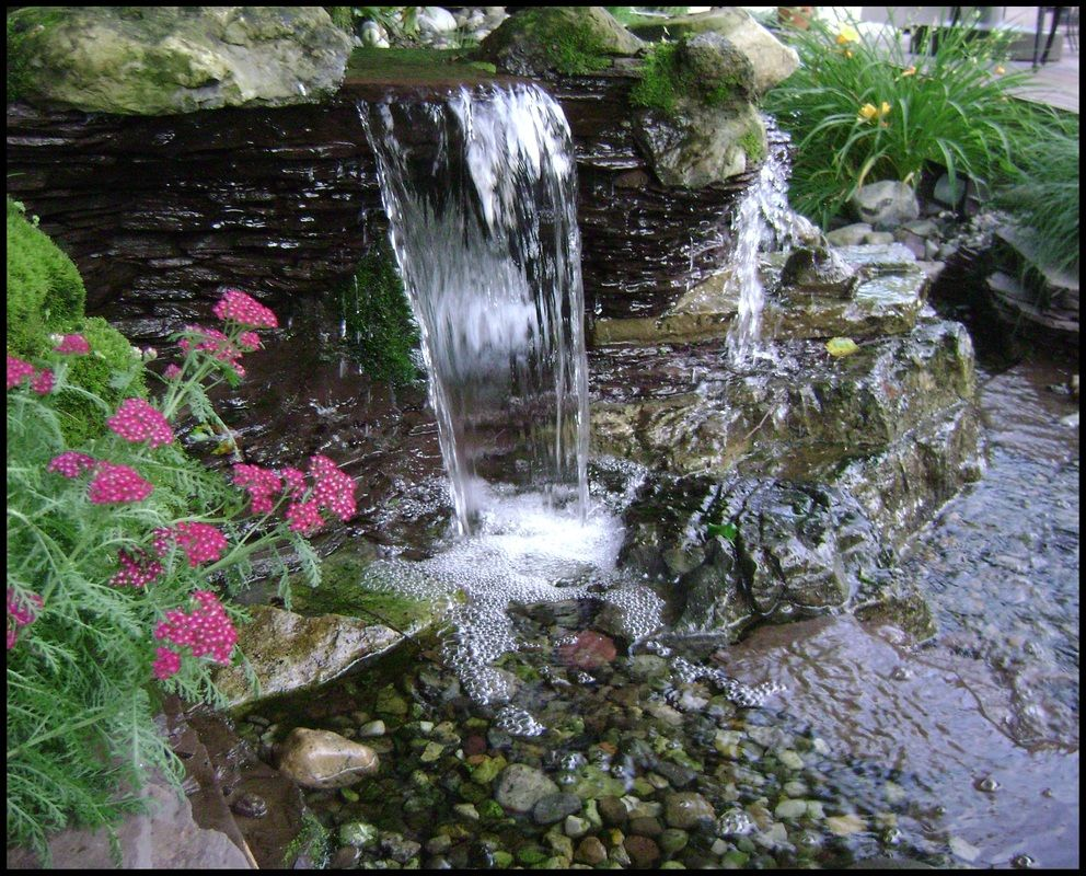 Backyard rock waterfalls small spaces google search for Rock waterfall pond