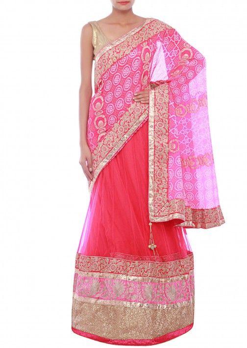 Fuschia lehenga saree embellished in zari and bandhej only on Kalki