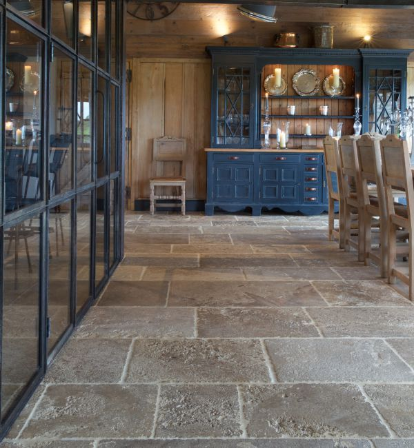 FLOOR Vieux Bourgogne limestone in a Artisan Ancient finish. These rustic  limestone flagstones look great in a country kitchen.