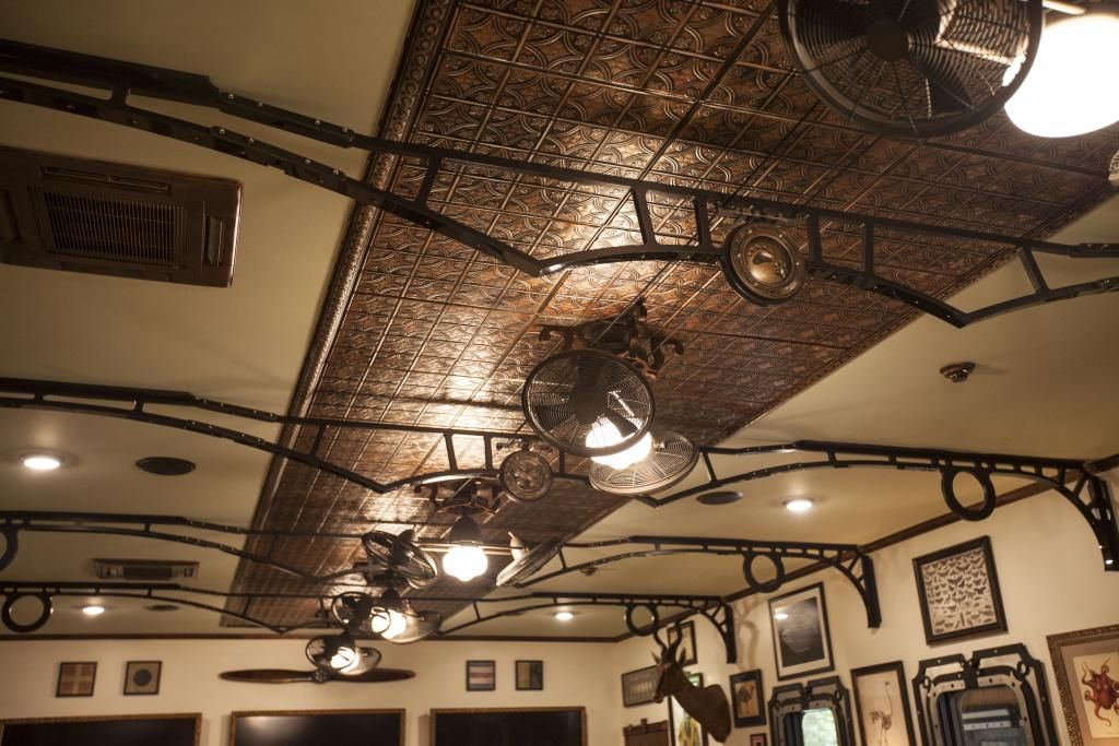 Ceiling fans in between each arch is a rotating ceiling fan with a fancy custom ceiling mount - Belt drive ceiling fans ...