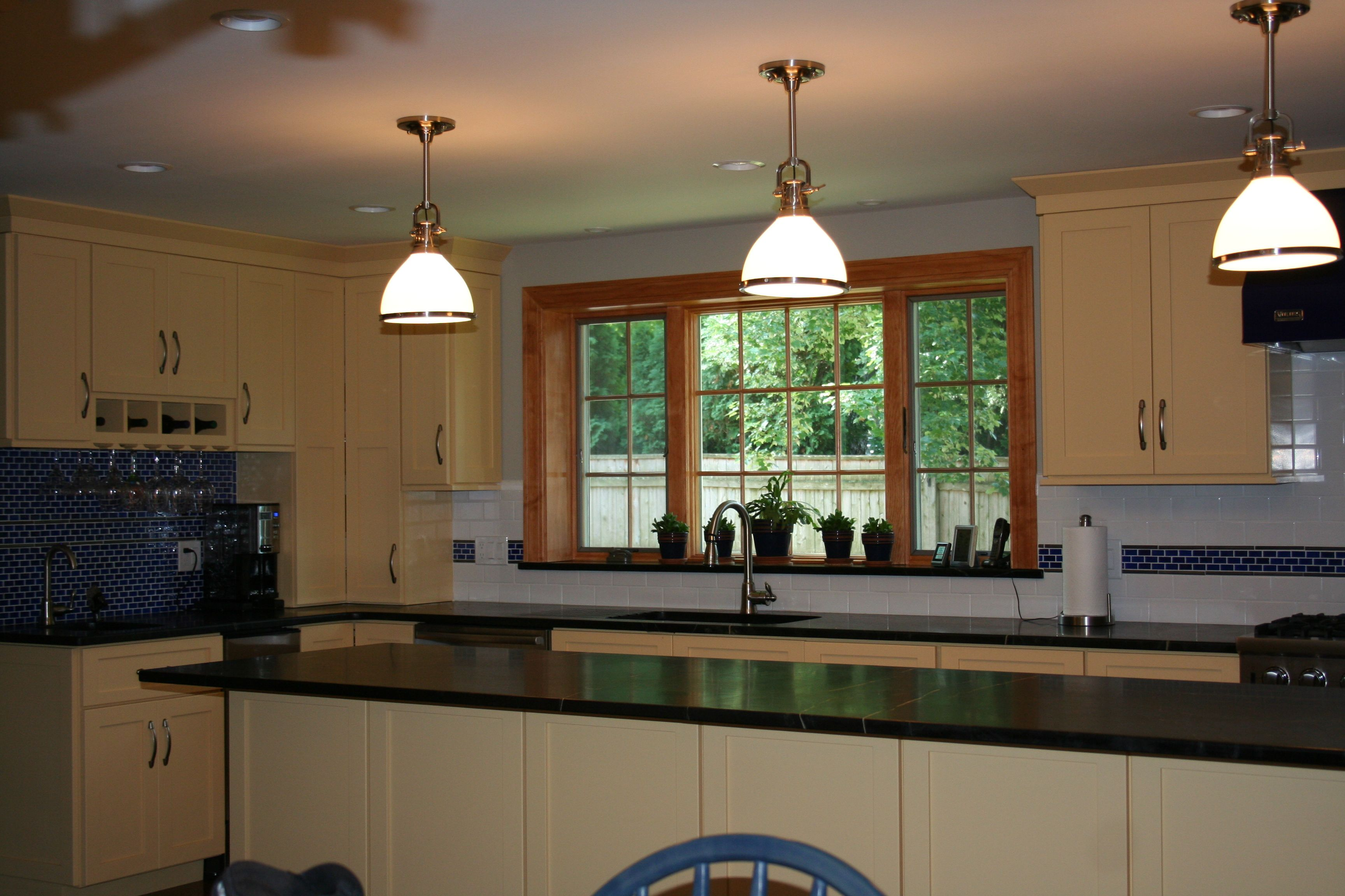 Lovely open kitchen with pendant lighting accessorize this