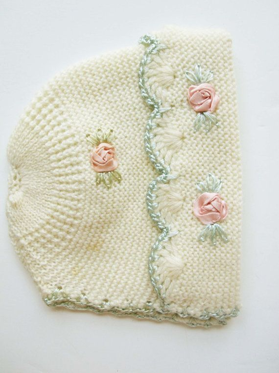 A Soft Cream Knit Baby\'s Hat With Pink Satin Flower Knots and Aqua ...