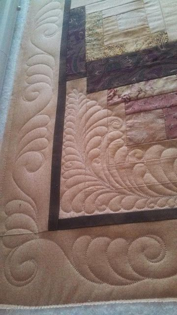 Seamingly Slawson Quilts--interesting one sided feather with a swirl