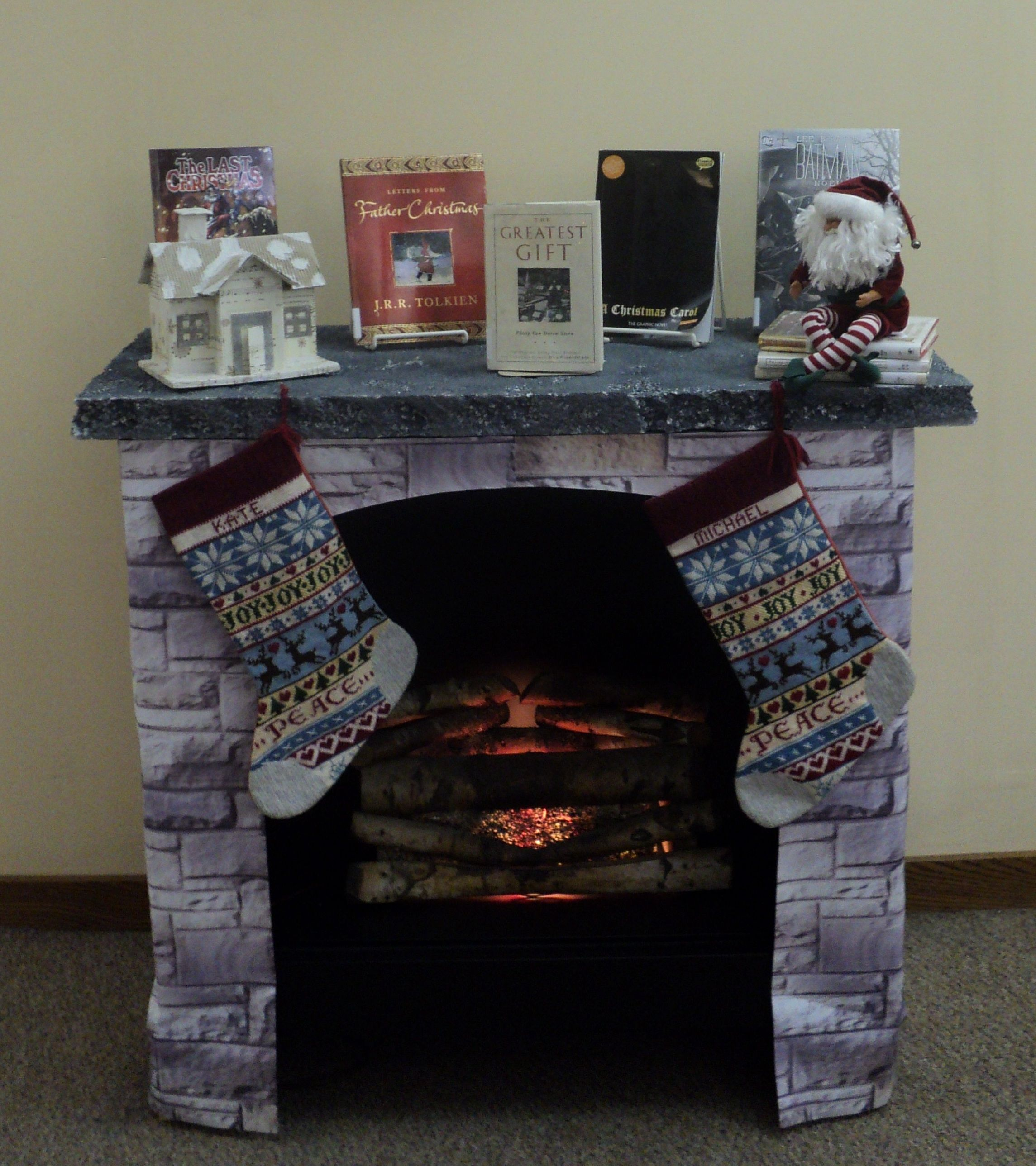 i had a lot of fun creating this faux fireplace with a book cart