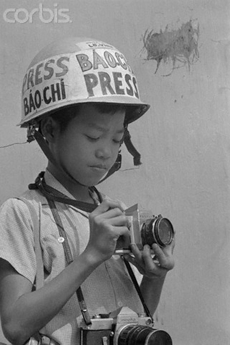 vintage everyday boy photographer seeks danger as others flee