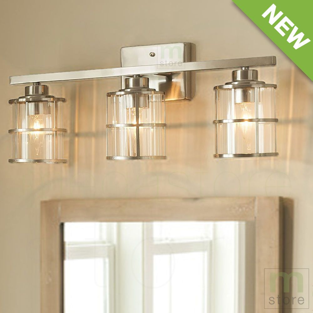 Bathroom vanity 3 light fixture brushed nickel cage wall lighting allen roth 3 light vanity bar with clear ribbed glass shades and decorative nickel accents aloadofball Images