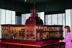 Titania's Palace is a miniature castle (Dollhouse) that was hand-built in Ireland by James Hicks & Sons, Irish Cabinet Makers, who were commissioned by Sir Nevile Wilkinson from 1907 to 1922. In 1978 Titania's Palace went up on Auction at Sotheby's England but was lost in a bidding war to Denmark where it remains on display today.