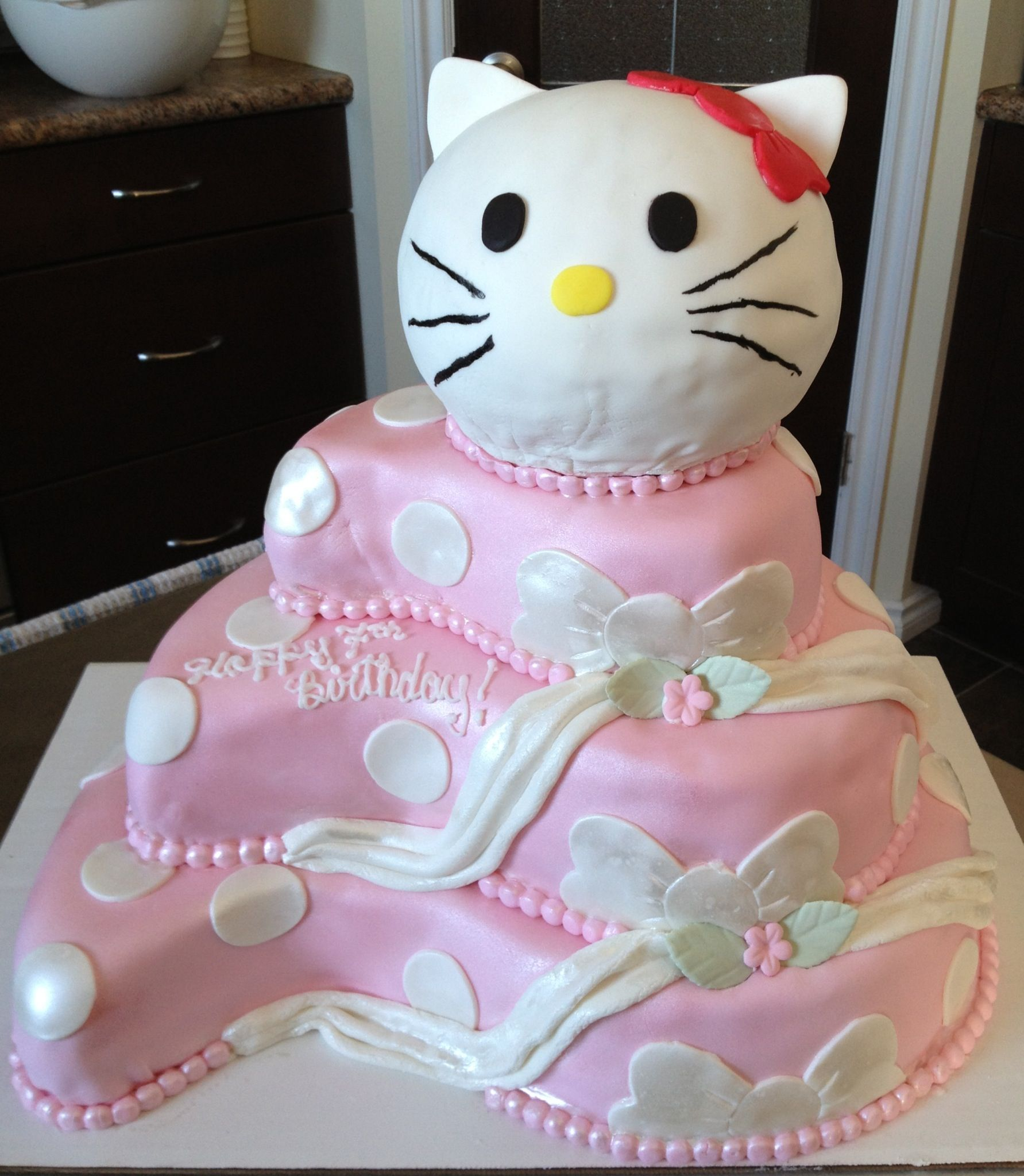 3 Tier Paisley Shaped Birthday Cake With A 3d Hello Kitty Head On