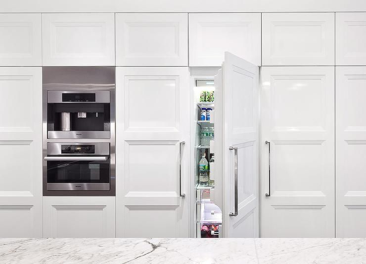 A wall of kitchen surround a hidden French doors