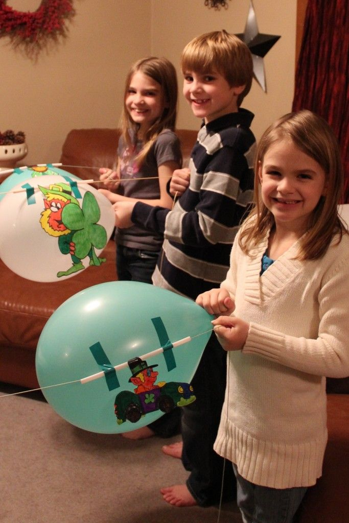 This racing leprechaun balloons could be adapted to any party.  Any size balloon can be used, just tape a straw to the balloon and run kite string through the straw. affix the other end of the string to the finish line.  Blow up balloons and let them go...