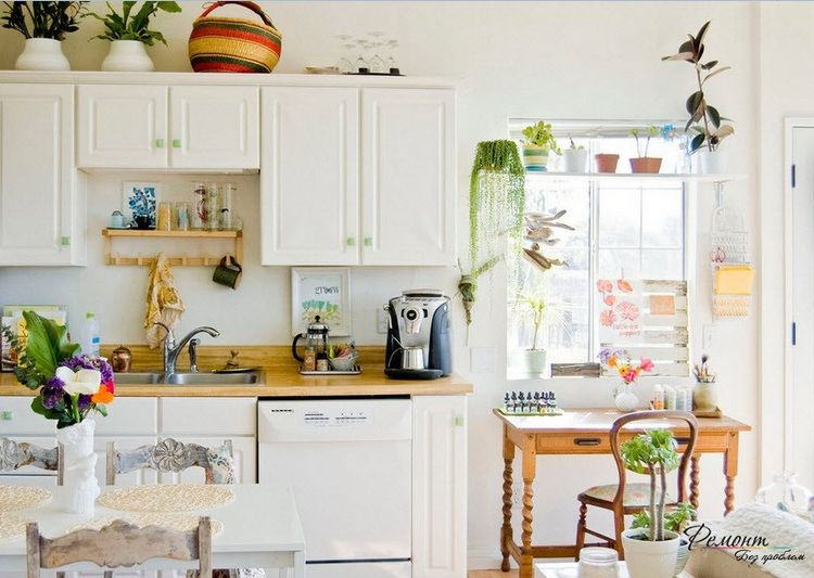 Greenery above kitchen cabinets ideas with decorative plants in pots on cobalt blue and yellow kitchen cabinets, plants on top of fencing, plants for kitchen cabinet tops, ideas for tops of cabinets, plants that grow at night, greenery for above kitchen cabinets, words for above kitchen cabinets, artificial plants for kitchen cabinets, fake plant for tops of cabinets, plants on top of toilets, plants on top of refrigerator, plants on top of tables,