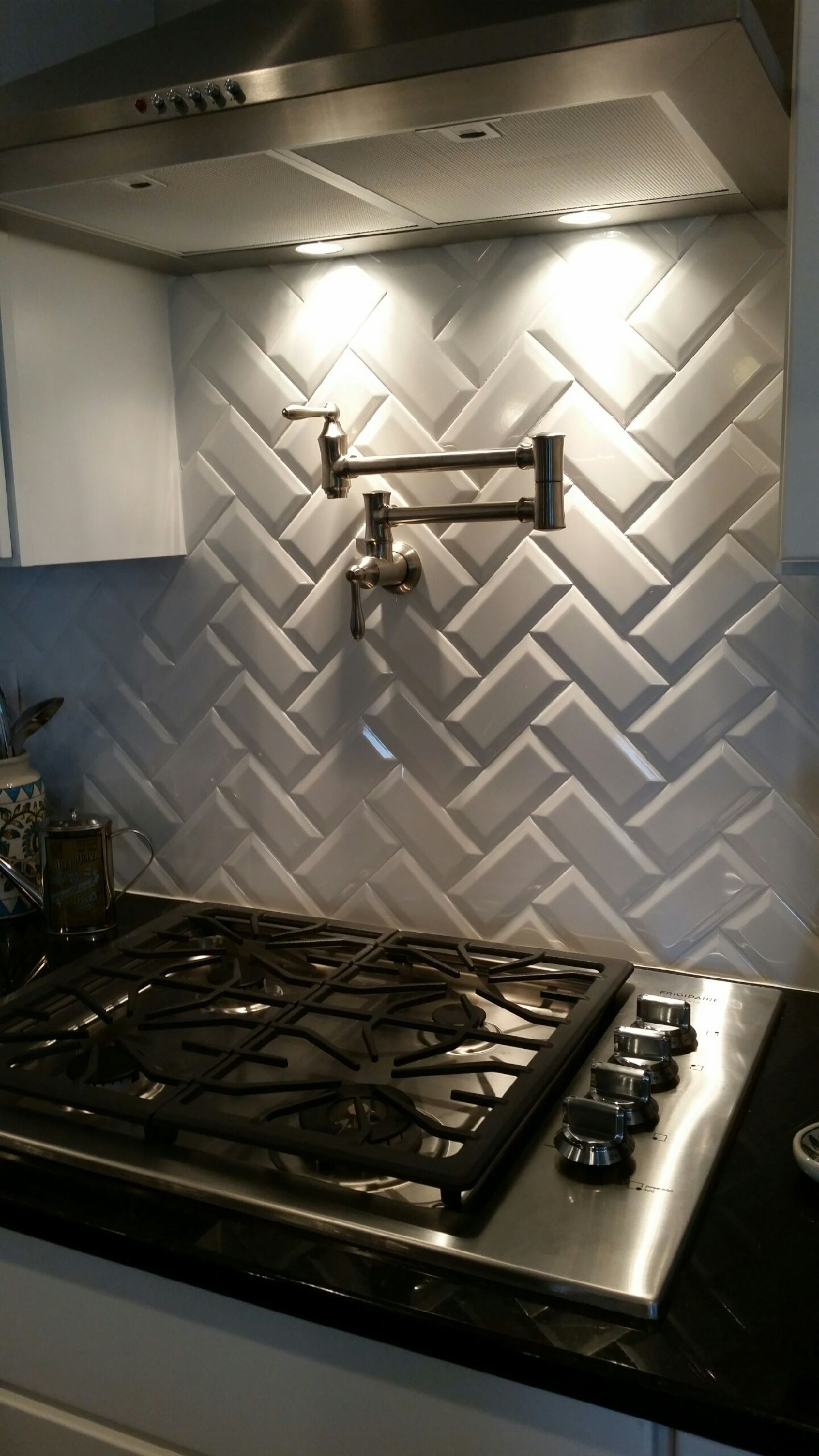 back splash white beveled subway tiles in chevron pattern with pot filler in meritage - Metal Tile Home 2016