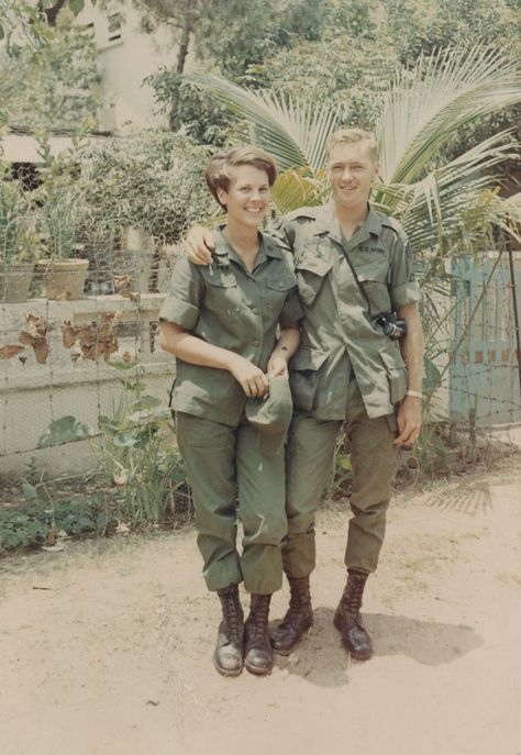 WAC Lee Wilson and soldier Del Height, both in field uniforms with boots, pose outdoors in Saigon, Vietnam, circa 1968.