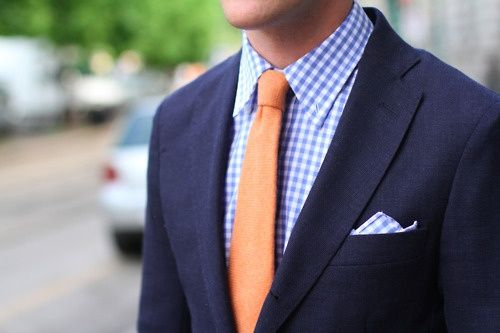 Navy Suit, Blue Gingham Shirt Pocket Square, Orange Tie. Coral tie + checked