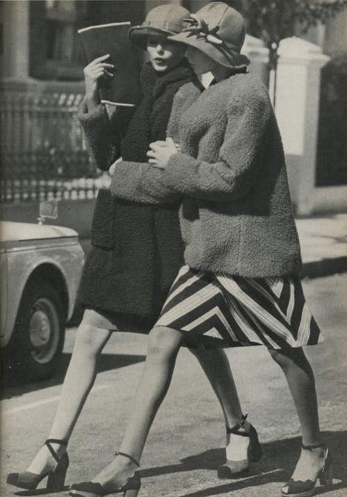 Girlfriends walking arm in arm...