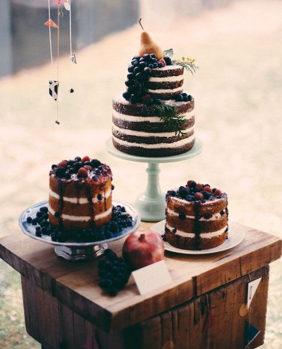 Brooklyn based Alana Jones-Mann's trio of rustic, unfrosted cakes were topped with dark fruits and cut by candlelight at the bride and groom's outdoor reception. #InStyle