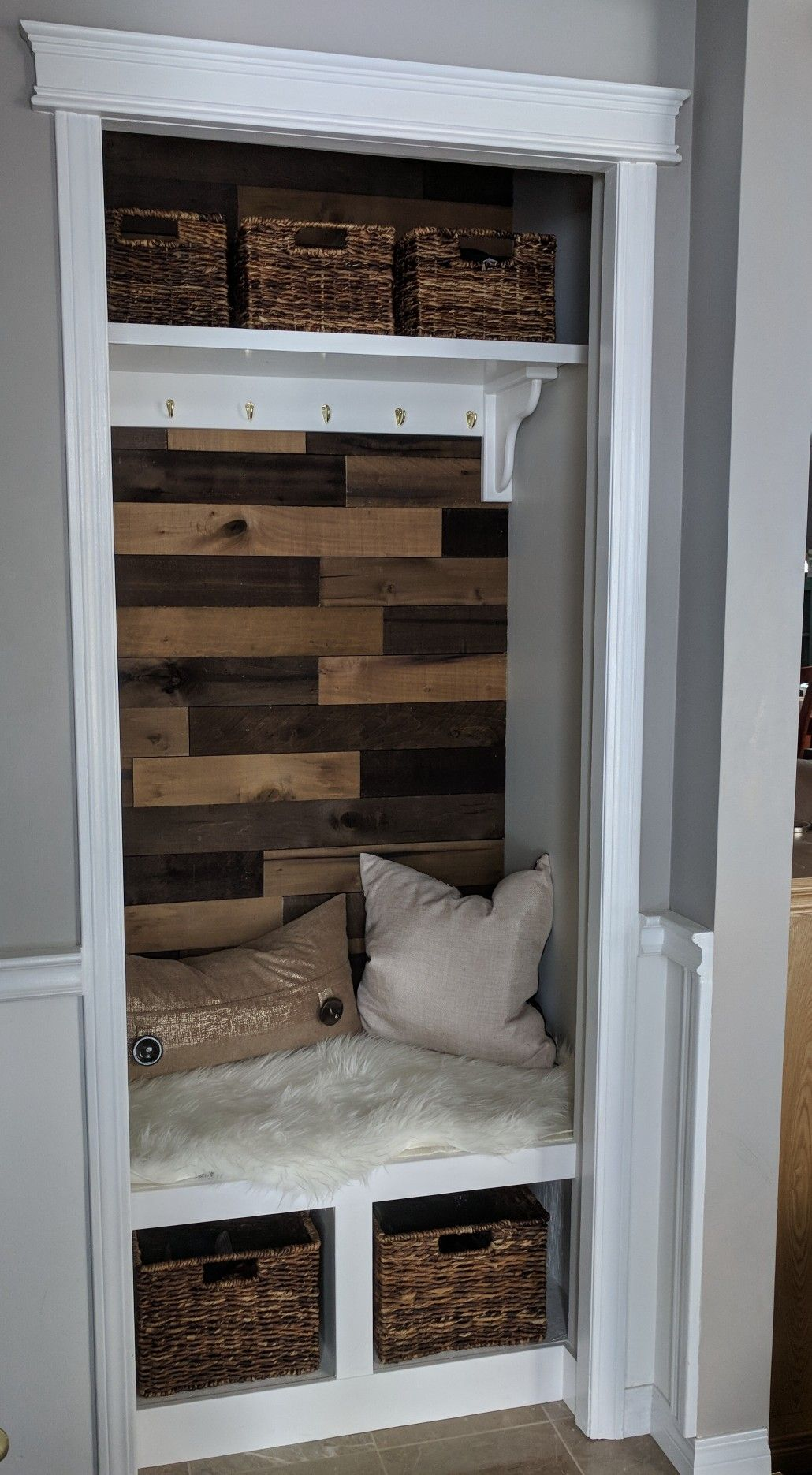 Turned open entryway closet with shelves into mini mudroom