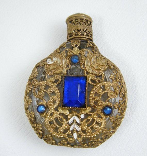 Vintage Czech Rhinestone Jeweled Filigree Miniature Perfume Bottle. $23.00, via Etsy.