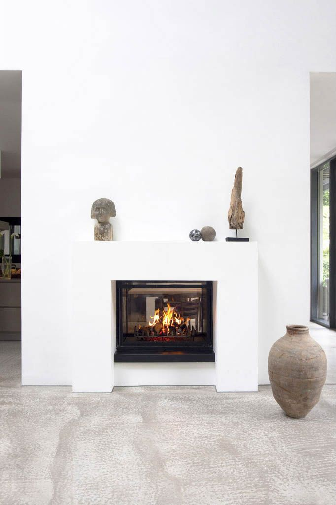 ein tunnelkamin in einer wandscheibe zwischen wohn und essraum der einsatz ist von rueegg typ. Black Bedroom Furniture Sets. Home Design Ideas