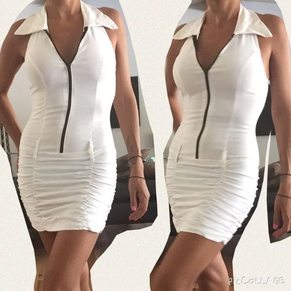 White Halter Dress This cute white halter dress has a scrunched skirt. It can be worn with a belt and zips up Dresses