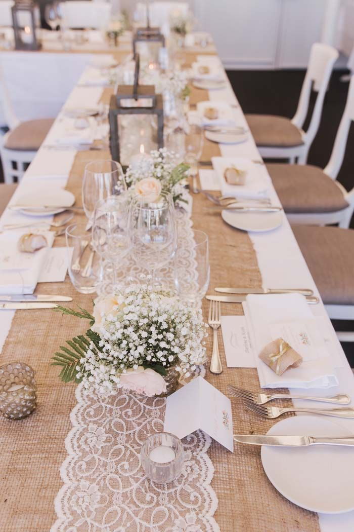 Photo of Lace and hemp table runner for a beach wedding reception. Credits in the …