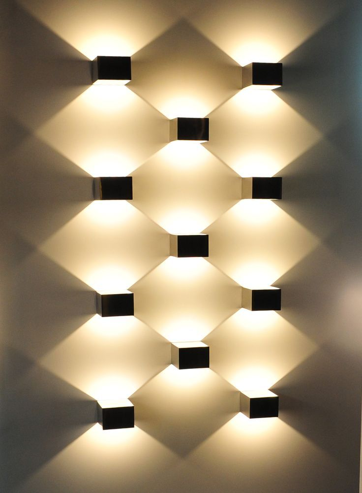 Use directional light to create geometrical wall art piece - broken design holzmobel