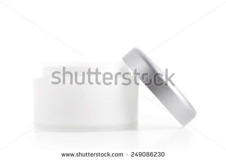 Facial cream in jar on white - stock photo