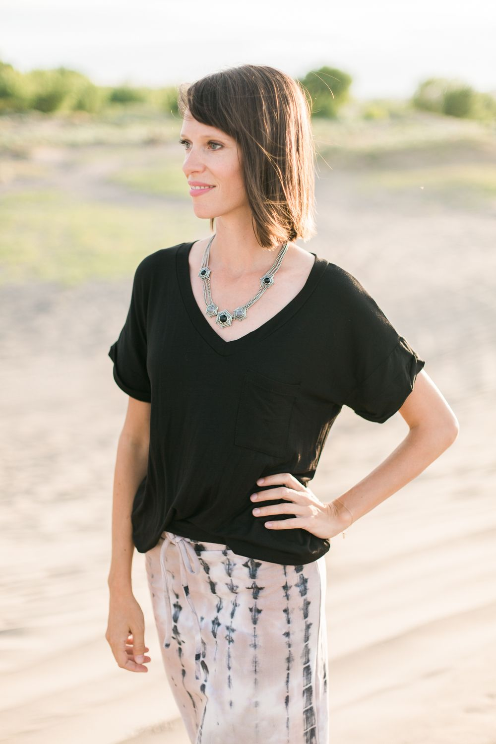 Black, oversized v neck tee with a pocket!   Model is 6' wearing size Small