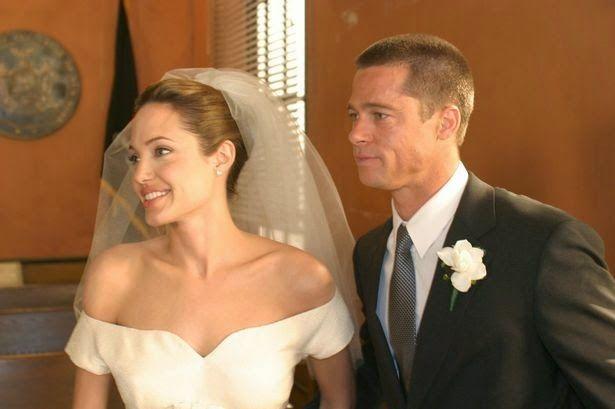 Brad Pitt And Angelina Jolie Wedding Morgan Magazine Angelina Jolie Wedding Movie Wedding Dresses Wedding Movies
