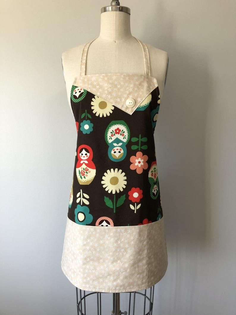 """Handmade aprons by me in high quality cotton! Three pockets included and comes with a matching pot holder. Adjustable neck strap and adjustable waist straps. A perfect gift for someone or yourself for all your baking needs! Size: one size fits all Width - 23.5"""" Height - 25.5"""" Matching Pot Holders - 8"""" by 8"""" #Aprons #Handmade #Style #Fashion #MadeWithLove #CookingAprons #BakingAccessories #BaristaAprons #HandmadeChristmas #ChristmasGifts #UniqueGifts #RussianDolls"""