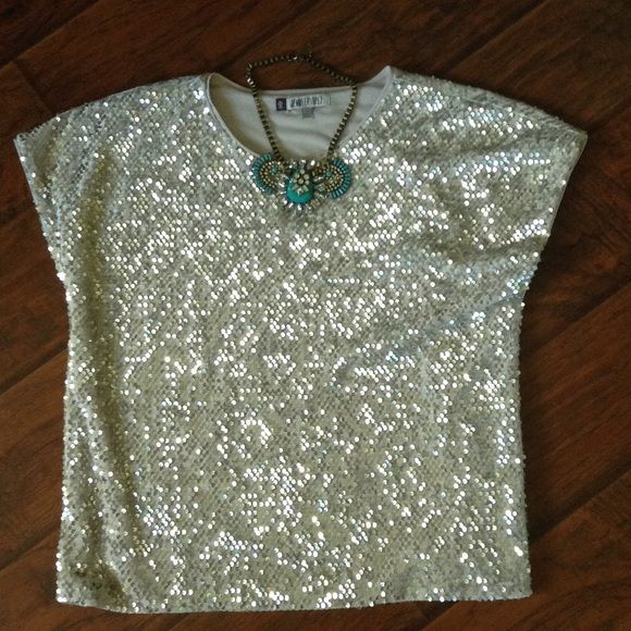 Sequin & Velour Top size L Fantastic sequin & velour top size large. Worn once (New a Years Eve). Great with jeans or as pictured with a black skirt!! Jennifer Lopez Tops