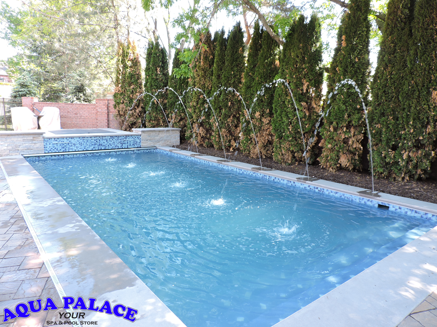 Fiberglass Inground Pool With Custom Water Features Tile And Auto Cover Enjoy The Hot Tub While Overlooki Pool Custom Water Feature Inground Fiberglass Pools