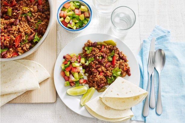 Try this quick and tasty Mexican dish served with fresh avocado salsa.