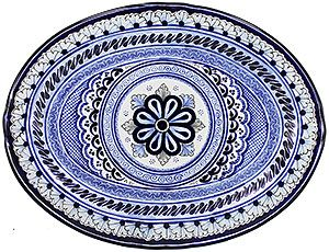 These colorful, handmade Talavera platters are ideal for serving any type of food and make a perfect highlight to any dining table or service area.  As decoration, the platters will make a colorful addition to any room's decor.  This particular platter is beautifully hand-crafted by the La Cupula ceramic studio in Puebla, Mexico.  Every authentic Talavera platter offered by La Fuente Imports is 100% lead free, chip resistant, as well as microwave, oven, and dishwasher safe!