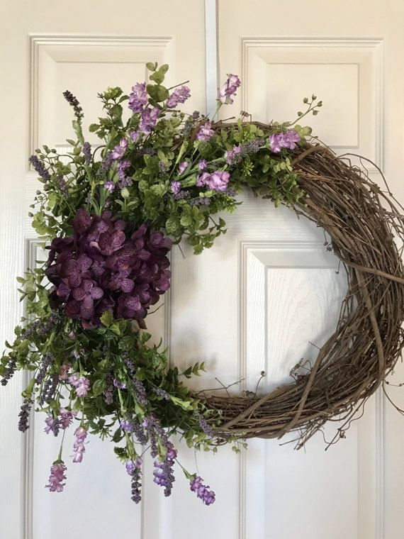 Grapevine wreath with pinks and purples