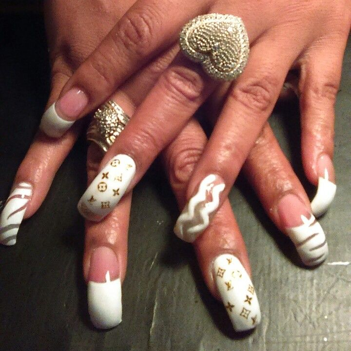 All white curve hawk set 3d zig zags going down her nail with Louis ...