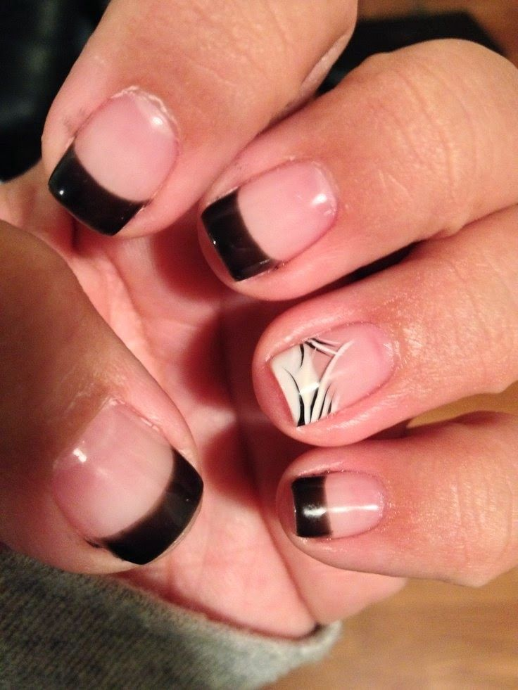 I like the white French tip nail with the black accent brush strokes ...