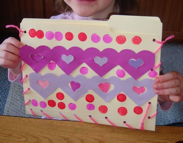 lace up a file folder to hold valentines or special projects marked with the school year - Valentine Bags For School