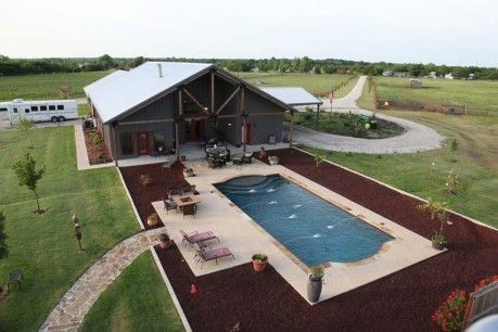 Mueller Steel Buildings // Ranch House made using a steel building frame. LOVE everything about this - the circular drive, spacious side porch by the pool, and a path out the back going to the barns and  arena. #steelbuildings