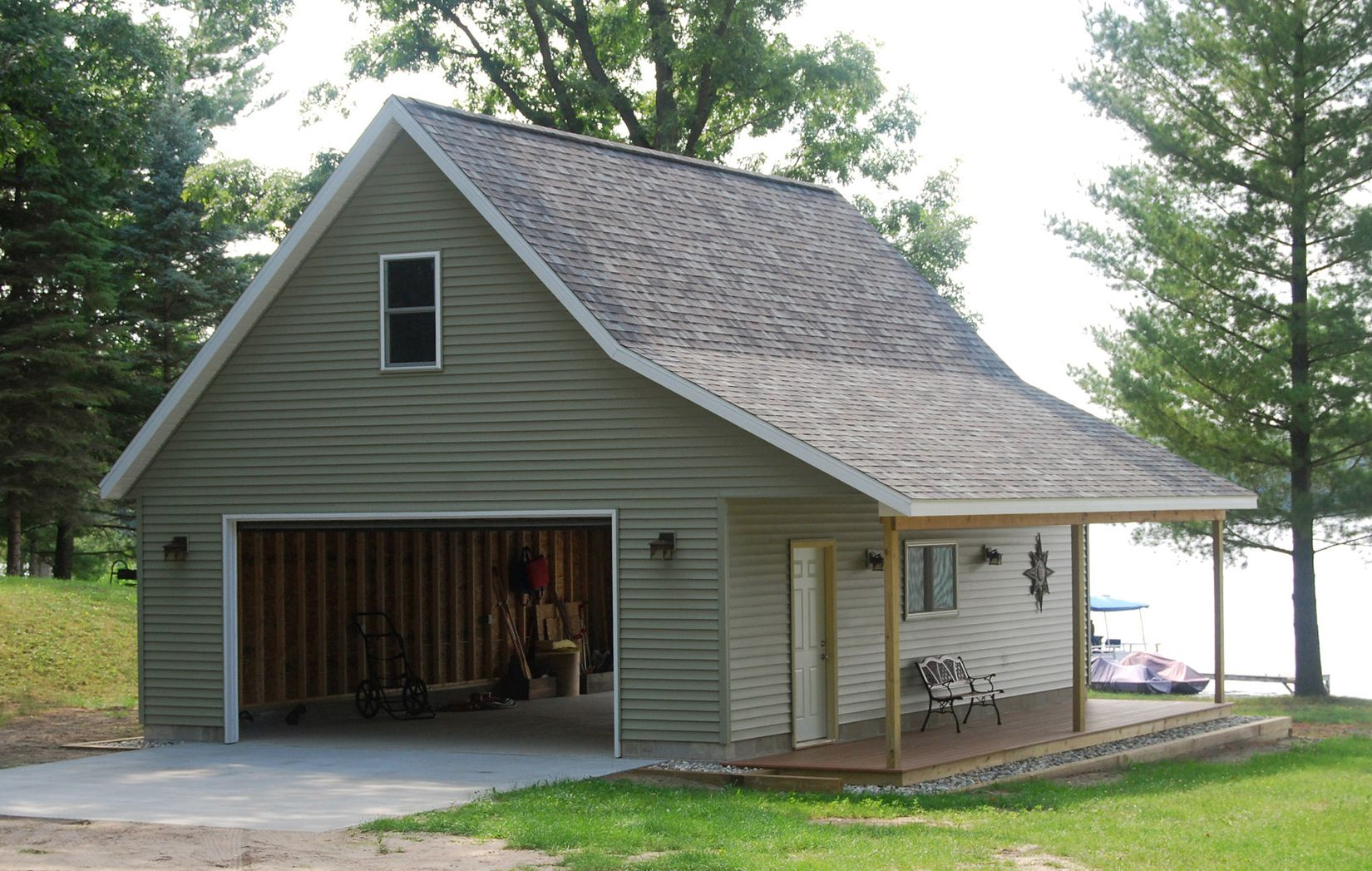 Pole barn garage on pinterest pole barns metal shop for Barn with porch