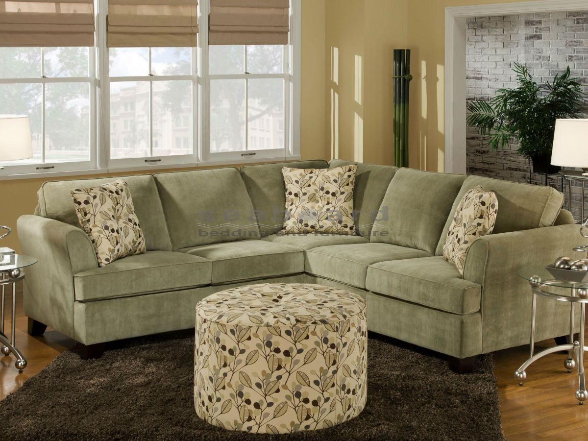 This transitional two piece sectional sofa is a great way to update your living room with stylish seating. Flared arms on either side, tapered wood block and simple box cushions gives this sofa its style. With four spots for you and your family to gather you can create a welcoming living room.