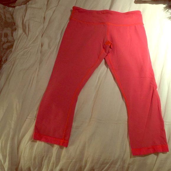 Lululemon crop pant size 8. Size 8 Lululemon crop luon pants.  Coral orange color, also reversible.  Lightly worn. lululemon athletica Other